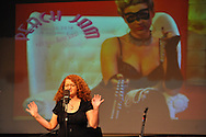 Kim Vodicka recites poetry at Peach Jam, a celebration of female poets and musicians, at the Powerhouse in Oxford, Miss. on Wednesday, March 26, 2014.