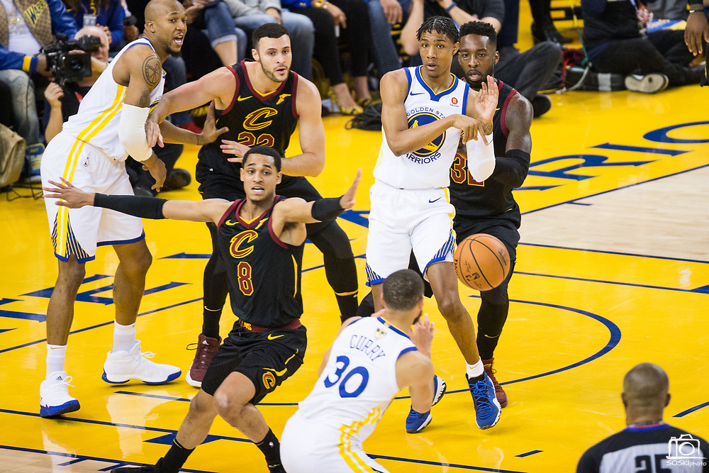 Golden State Warriors guard Patrick McCaw (0) passes the ball out to Golden State Warriors guard Stephen Curry (30) during Game 1 of the NBA Finals against the Cleveland Cavaliers at Oracle Arena in Oakland, Calif., on May 31, 2018. (Stan Olszewski/Special to S.F. Examiner)