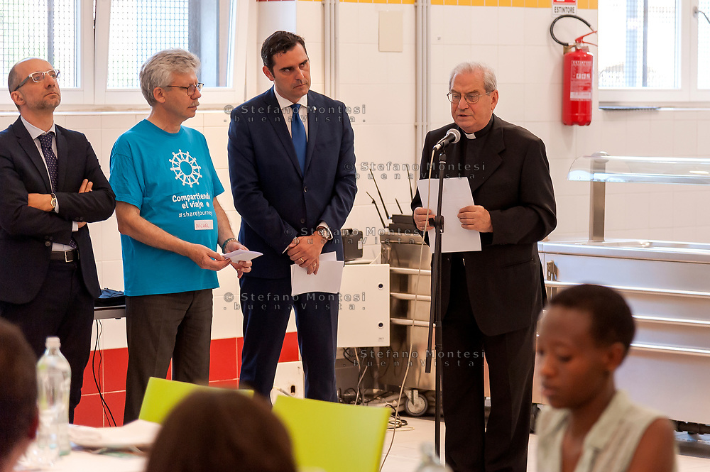 ROME, ITALY - JUNE 19: Michel Roy, Secretary General of Caritas Internationalis and Mgr Enrico Feroci, Director of Caritas Rome during the Day of Refuge, at the 'San Giovanni Paolo II' canteen in Via Marsala, the diocesan Caritas of Rome organized 'The Meal of the Meeting', with migrants and refugees to share the migratory experience. This is part of the awareness campaign 'Share the Journey' promoted by Caritas Internationalis and launched by Pope Francis on 27 September last on June 19, 2018 in Rome, Italy.