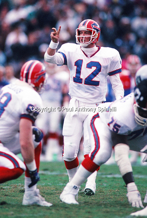 Buffalo Bills quarterback Jim Kelly (12) holds up two fingers as he audibles during the NFL football game against the Los Angeles Raiders on Dec. 8, 1991 in Los Angeles. The Bills won the game 30-27 in overtime. (©Paul Anthony Spinelli)