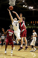 January 24th, 2013 Boulder, CO - Colorado Buffaloes freshman guard Eli Stalzer (5) attempts a shot as he splits the Stanford defense during the NCAA basketball game between the Stanford Cardinal and the University of Colorado Buffaloes at the Coors Events Center in Boulder CO