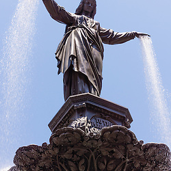 Photo of Cincinnati Tyler Davidson fountain named The Genius of Water. Located in Fountain Square in downtown Cincinnati, Ohio, the statue is one of the city's most popular attractions.