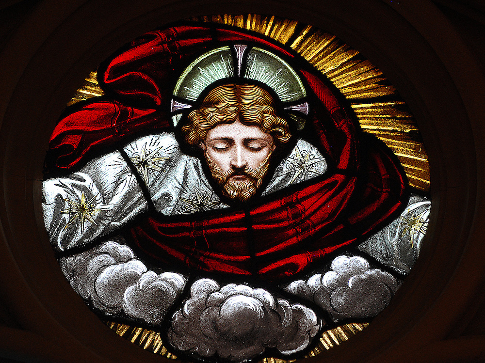 Jesus peers down from heaven in this stained glass image. (Sam Lucero photo)