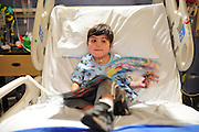 John Camacho-Sepulveda (5) flips through his new book at Children's Medical Center in Dallas on Wednesday, April 3, 2013. (Cooper Neill/The Dallas Morning News)