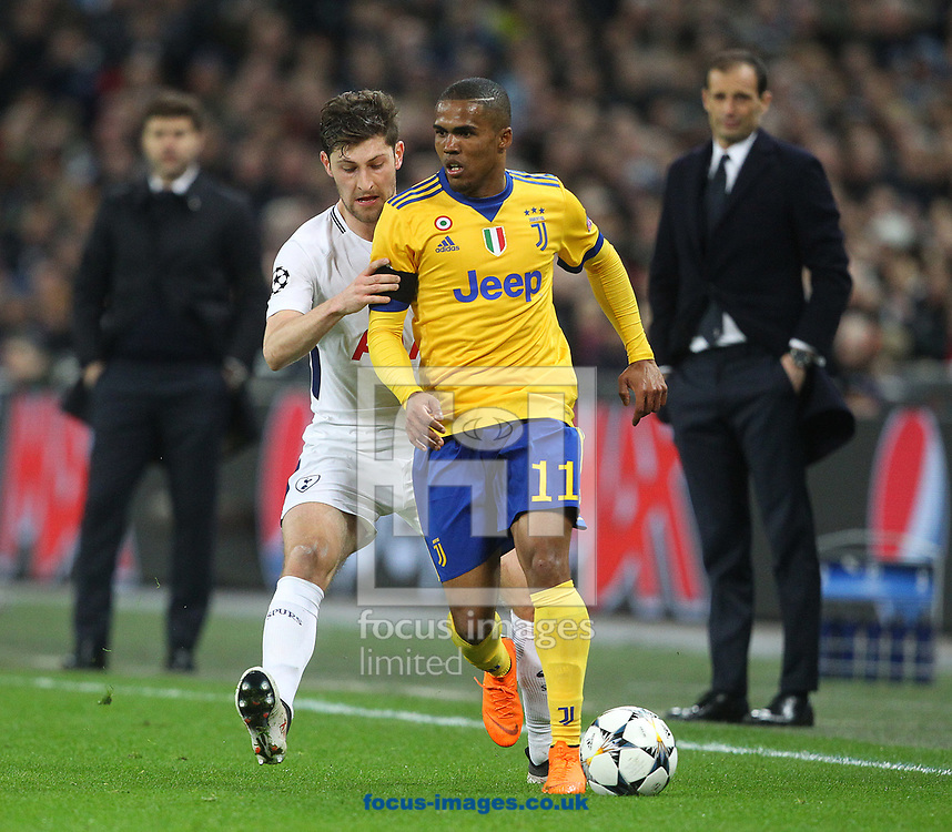 Ben Davies of Tottenham Hotspur and Douglas Costa of Juventus during the UEFA Champions League match at Wembley Stadium, London<br /> Picture by Paul Chesterton/Focus Images Ltd +44 7904 640267<br /> 06/03/2018