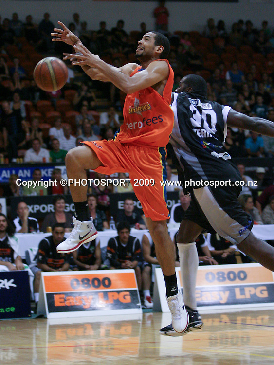 Shark's Rene Rougeau has the ball ripped away by Jamil Terrell. Hawkes Bay Hawks v Southland Sharks. National Basketball League. Pettigrew Green Arena, Napier, New Zealand. Friday 19 March 2010. Photo: John Cowpland/PHOTOSPORT
