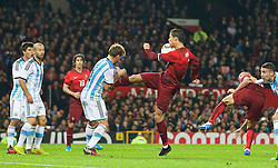 MANCHESTER, ENGLAND - Tuesday, November 18, 2014: Portugal's captain Cristiano Ronaldo kicks Argentina's Lucas Biglia in the stomach during the International Friendly match at Old Trafford. (Pic by David Rawcliffe/Propaganda)