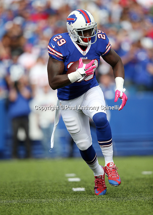 Buffalo Bills running back Karlos Williams (29) runs the ball in the third quarter during the 2015 NFL week 4 regular season football game against the New York Giants on Sunday, Oct. 4, 2015 in Orchard Park, N.Y. The Giants won the game 24-10. (©Paul Anthony Spinelli)
