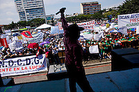 A man rallies supporters of the President as citizens take to the streets as a day of protest in connection with Guatemala's President Alvaro Colom fill the Central Plaza in Guatemala City May 17, 2009. . Thousands of protesters took to the streets of the capital  Sunday in two separated rival marches, one in support of the President and one denouncing President Alvaro Colom who was accused this week of murder, money laundering and having ties with narco-traffickers.(Darren Hauck)