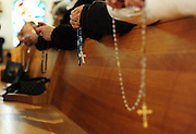 Worshipers join in recitation of the rosary before Mass at the Shrine of Our Lady of Good Help. (Sam Lucero photo)