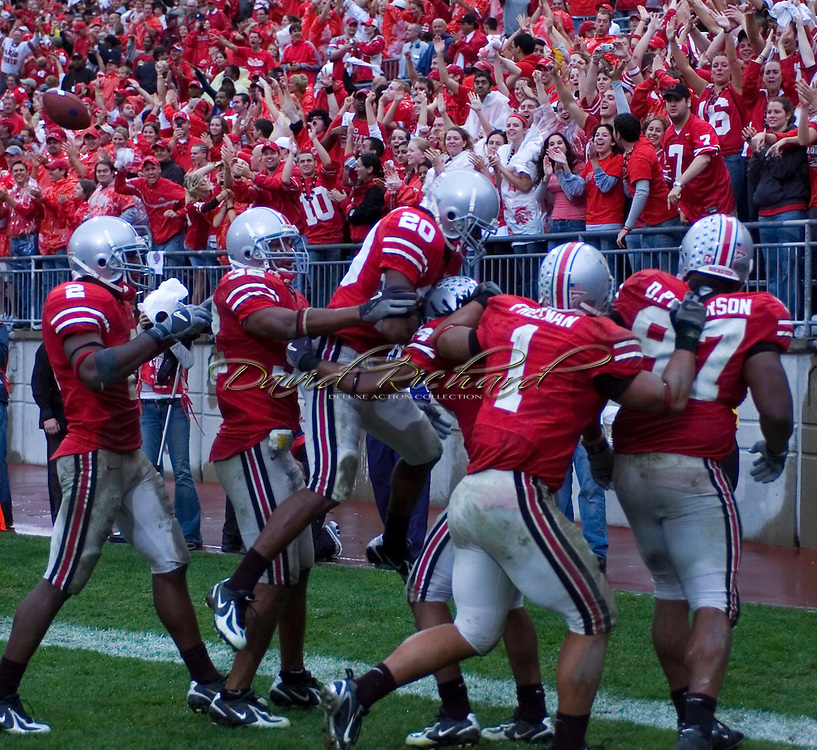 MORNING JOURNAL/DAVID RICHARD.Ohio State's defense celebrates after Antonio Smith returns an interception for a 55-yard touchdown yesterday in the fourth quarter.