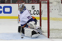 Apr 3; Newark, NJ, USA; New York Islanders goalie Al Montoya (35) makes a save during the first period at the Prudential Center.