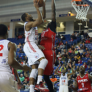 Delaware 87ers Forward Rahlir Hollis-Jefferson (15) drives towards the basket as Rio Grande Valley Vipers Forward Clint Capela (32) defends in the first half of a NBA D-league regular season basketball game between the Delaware 87ers and the Rio Grande Valley Vipers (Houston Rockets) Saturday, Dec. 27, 2014 at The Bob Carpenter Sports Convocation Center in Newark, DEL