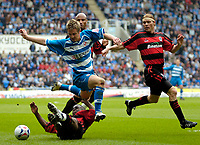 Photo: Ed Godden.<br /> Reading v Queens Park Rangers. Coca Cola Championship. 30/04/2006. Kevin Doyle (Reading), leaps over a QPR player.