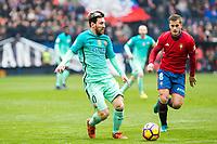 FC Barcelona's Leo Messi , Club Atletico Osasuna's Goran Causic during the match of La Liga between Club Atletico Osasuna and Futbol Club Barcelona at Sadar Stadium in Pamplnoa , Spain. December 10, 2016. (ALTERPHOTOS/Rodrigo Jimenez)