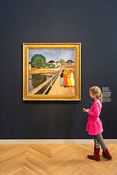 Young girl visitor looking at painting, The Girls on the Bridge, by Edvard Munch  at new Museum Barberini in Potsdam Germany