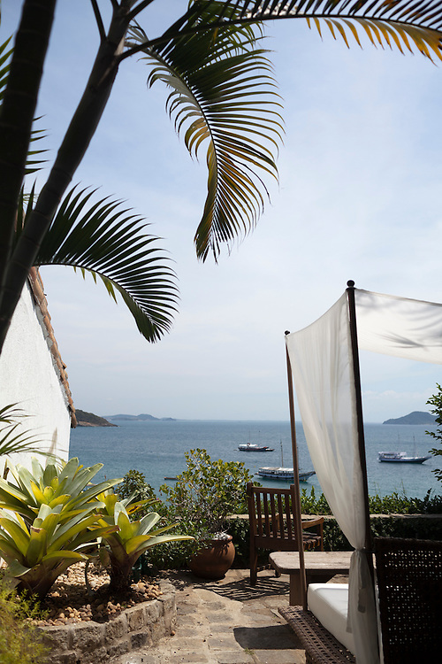 Rustic courtyard at Casa Brancas Boutique Hotel and Spa with a view of Buzios Bay