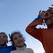 Egypt, Luxor. December/17/2008...Kids at Karnak temple asking for a photograph.