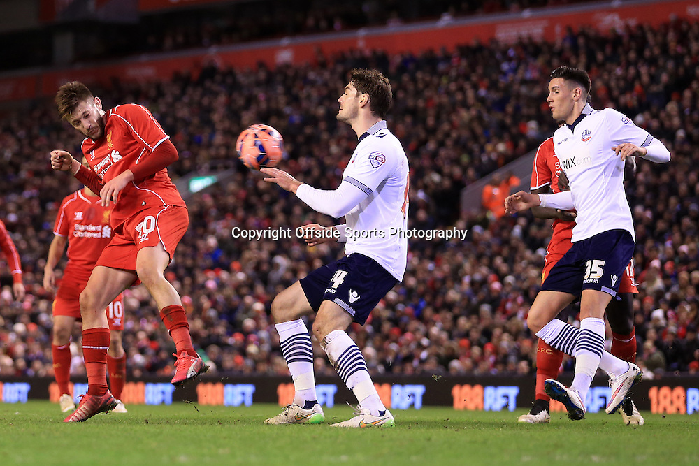 24th January 2015 - FA Cup - 4th Round - Liverpool v Bolton Wanderers - Adam Lallana of Liverpool winces as he fires a header at goal - Photo: Simon Stacpoole / Offside.