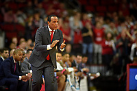Men's basketball coach Kevin Keatts applauds his team during ACC action against UVA in PNC Arena.
