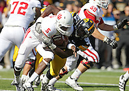 October 22, 2011: Indiana Hoosiers quarterback Tre Roberson (5) is sacked by Iowa Hawkeyes defensive lineman Broderick Binns (91) during the first half of the NCAA football game between the Indiana Hoosiers and the Iowa Hawkeyes at Kinnick Stadium in Iowa City, Iowa on Saturday, October 22, 2011. Iowa defeated Indiana 45-24.