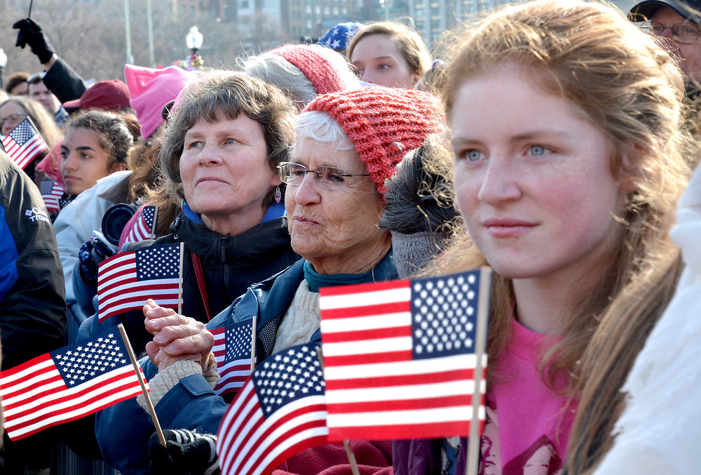 (BOSTON, MA 012117) Women listen to speakers before the Women's March For America. Staff photo Chris Christo