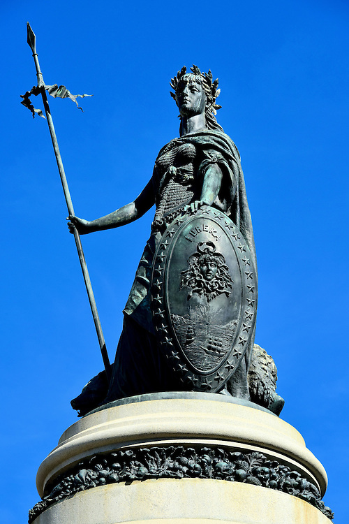Pioneer Monument Eureka Statue in San Francisco, California<br /> This bronze statue of Minerva, the Roman goddess of wisdom, with the word &ldquo;Eureka&rdquo; on her shield stands on top of the Pioneer Monument, an 800 ton granite pedestal with sculptures and reliefs that depict early California history. &ldquo;Eureka&rdquo; refers to the discovery of gold in 1848.  It is the state&rsquo;s motto and part of the California State Seal.