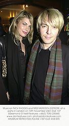 Musician NICK RHODES and MISS MEREDITH OSTROM, at a party in London on 13th November 2001.	OUE 137