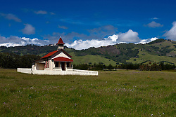 One room school house with Hearst Castle in the background, San Simeon, California, United States of America