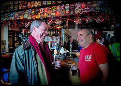 UKIP Leader Nigel Farage has a pint in the local pub with locals that have been affected by the flooding near  Burrowbridge, Somerset, United Kingdom. Sunday, 9th February 2014. Somerset has been flooded since the start of 2014, with people being forced to leave their homes. Picture by Andrew Parsons / i-Images
