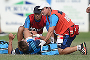 Piers Francis is attended to by Mark Plummer and Team doctor Stephen Kara during a pre season Super Rugby match. Blues v Storm, Pakuranga Rugby Club, Auckland, New Zealand. Thursday 4 February 2016. Copyright Photo: Andrew Cornaga / www.Photosport.nz