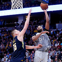 05 April 2018: Minnesota Timberwolves forward Taj Gibson (67) goes for the baby hook over Denver Nuggets center Nikola Jokic (15) during the Denver Nuggets 100-96 victory over the Minnesota Timberwolves, at the Pepsi Center, Denver, Colorado, USA.