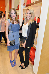 Left to right, ROSIE FORTESCUE and ASHLEY ROBERTS at the launch the Folli Follie Flagship store at 493 Oxford Street, London on 28th May 2015.