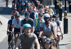 © Licensed to London News Pictures. 30/05/2020. London, UK. Large numbers of cyclists make their way through Parliament Square, outside the Houses of Parliament in Westminster, London. Government has announced a series of measures to slowly ease lockdown, which was introduced to fight the spread of the COVID-19 strain of coronavirus. Photo credit: Ben Cawthra/LNP