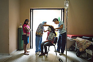 Nancy Likens and Anabis Vera Gonzales both volunteers with Central American Medical Outreach, inspect the ear of a patient the day following surgery at Occidente Hospital in Santa Rosa de Copan, Copan, Honduras March 1, 2017. Photo Ken Cedeno