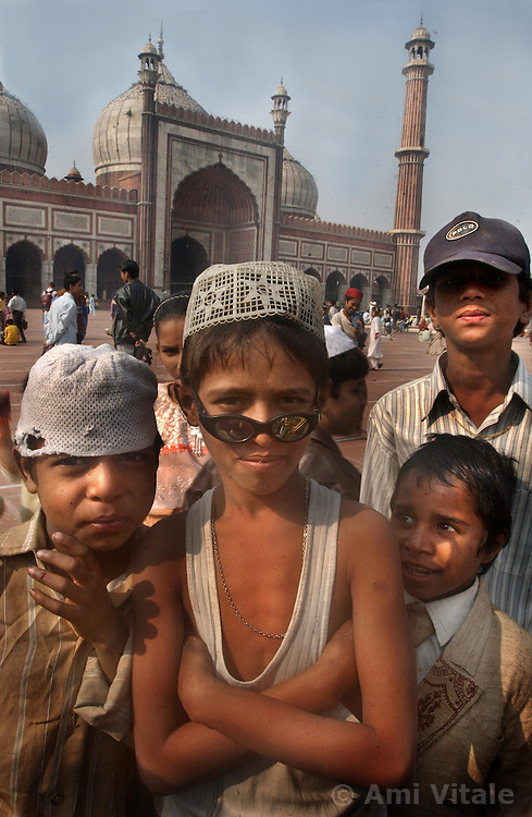 Young Muslim boys pose inside the Jamia Masjid, or Grand Mosque, the first day of the Muslim Eid al-Fitr holiday marking the end of the holy month of Ramadan in Delhi, India December 17, 2001.  (Getty Images/ Ami Vitale)