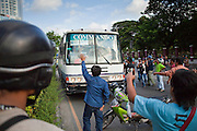 14 MAY 2010 - BANGKOK, THAILAND: Anti government protesters stop a bus of soldiers at the intersection of Rama IV and Witthayu Roads in Bangkok Friday morning. The troops' commander negotiated with the protesters and the bus was allowed to leave. Tensions among Red Shirt protesters demanding the dissolution of the current Thai government rose overnight after Seh Daeng, the Red Shirt's unofficial military leader was shot in the head by a sniper. Gangs of Red Shirts have taken over military checkpoints on Rama IV and are firing small rockets at military helicopters and army patrols in the area. Troops have responded by firing towards posters.  PHOTO BY JACK KURTZ