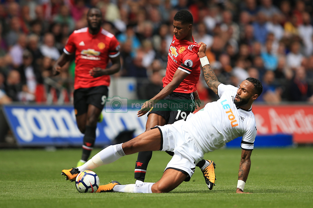 19 August 2017 -  Premier League - Swansea City v Manchester United - Marcus Rashford of Manchester United tangles with Kyle Bartley of Swansea City - Photo: Marc Atkins/Offside