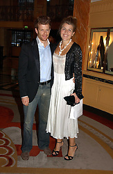 AMBER NUTTALL and TOM AIKENS at a party to celebrate the opening of The Bar at The Dorchester, Park Lane, London on 27th June 2006.<br />