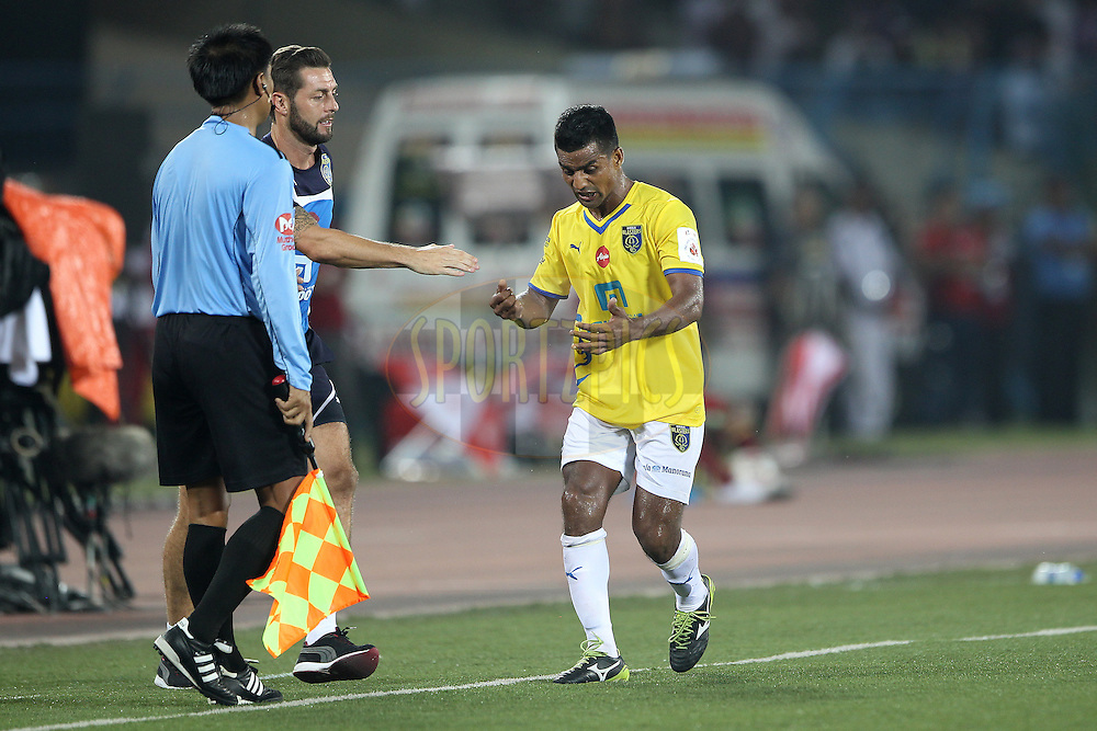 Mehtab Hossain of Kerala Blasters FC is restrained by support staff when challenging the linesman during match 13 of the Hero Indian Super League between Atl&eacute;tico de Kolkata and Kerala Blasters FC held at the Salt Lake Stadium in Kolkata, West Bengal, India on the 26th October 2014.<br /> <br /> Photo by:  Ron Gaunt/ ISL/ SPORTZPICS