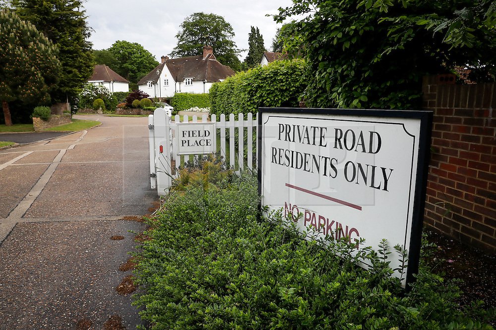 © London News Pictures. 21/05/2016. Weybridge, UK. The entrance to a residential street in St George's Hill, Weybridge, Surrey where the body of a woman in her 30's was discovered by paramedics this morning (Sat). Photo credit: Peter Macdiarmid/LNP