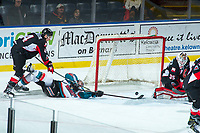 KELOWNA, CANADA - FEBRUARY 20: Joel Lakusta #4 of the Prince George Cougars checks Erik Gardiner #12 of the Kelowna Rockets to the ice as he scores a second period goal on February 20, 2018 at Prospera Place in Kelowna, British Columbia, Canada.  (Photo by Marissa Baecker/Shoot the Breeze)  *** Local Caption ***