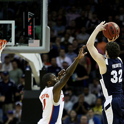 Mar 24, 2011; New Orleans, LA; Brigham Young Cougars guard Jimmer Fredette (32) shoots over Florida Gators guard Kenny Boynton (1) during the second half of the semifinals of the southeast regional of the 2011 NCAA men's basketball tournament at New Orleans Arena. Florida defeated BYU 83-74.   Mandatory Credit: Derick E. Hingle