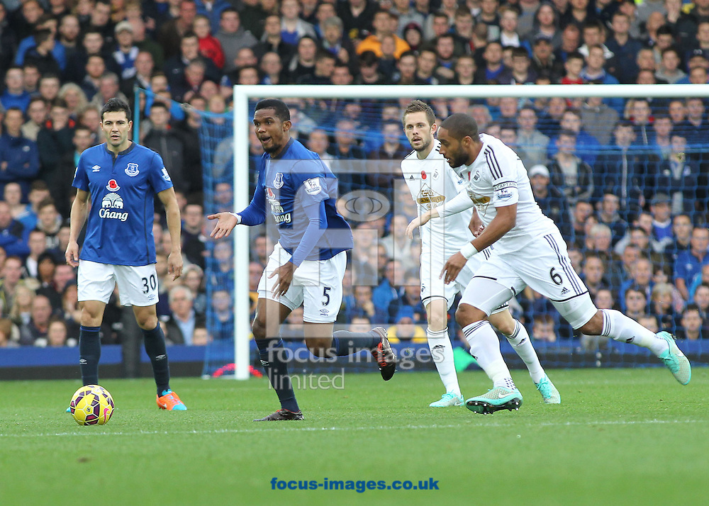 Samuel Eto'o of Everton and Ashley Williams of Swansea City in action during the Barclays Premier League match at Goodison Park, Liverpool.<br /> Picture by Michael Sedgwick/Focus Images Ltd +44 7900 363072<br /> 01/11/2014