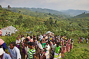 Local villagers from the Batwa tribe and others from the community head home after the funeral of Matale, a local woman who recently died of cancer.