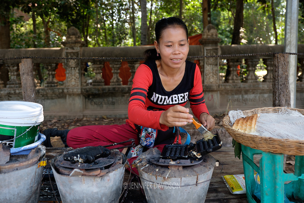 A vendors sells waffles on a street in Siem Reap, Cambodia.