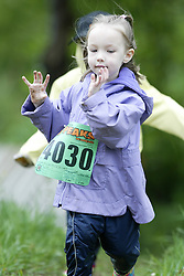 "(Kingston, Ontario---16/05/09) ""Emily Meers running in the kids race at the 2009 Salomon 5 Peaks Trail Running series Race held in Kingston, Ontario as part of the Eastern Ontario/Quebec division. ""  Copyright photograph Sean Burges / Mundo Sport Images, 2009. www.mundosportimages.com / www.msievents.com."