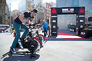 General Public, March 19, 2014 - Ironman Triathlon : Visitors to Federation Square compete in the instant triathlon. Tougher Than An IRONMAN, Federation Square, Melbourne, Victoria, Australia. Credit: Lucas Wroe