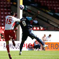 Photo: Steve Bond.<br />Walsall v Swansea City. Coca Cola League 1. 25/08/2007. Jason Scotland (R) and Scott Dann (L) challange for the ball