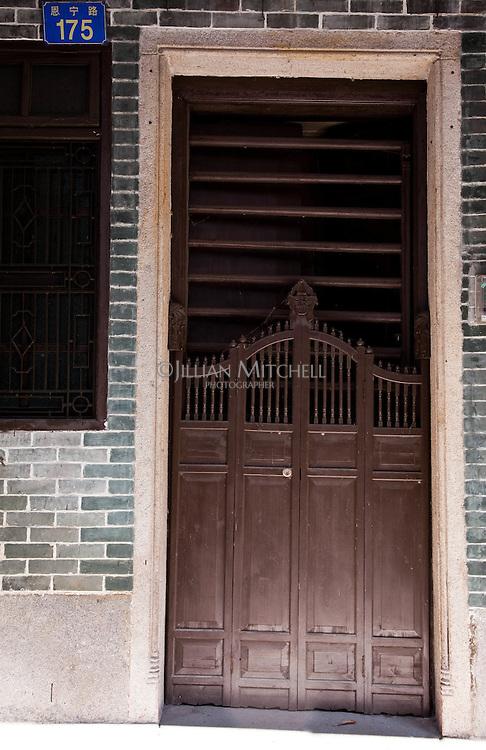 Beautiful ancient doors on the old Qilou buildings on En Ning Road in Guangzhou.